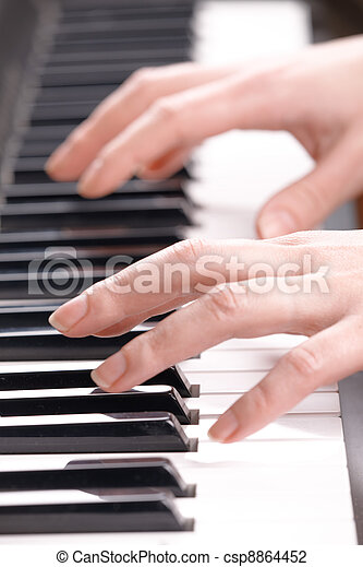 Woman's hands playing music on the piano - csp8864452