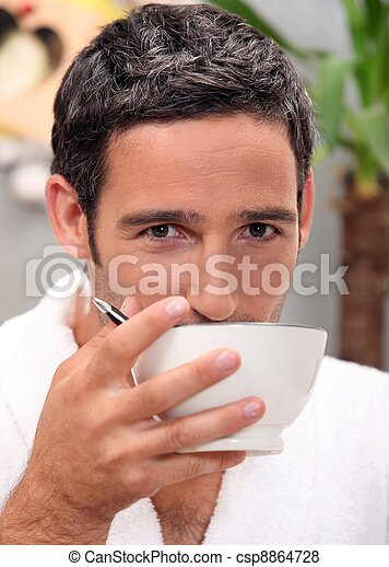 Man having cup of coffee at home - csp8864728