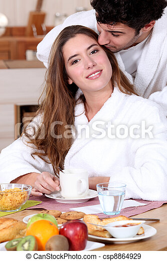 Couple having a leisurely breakfast - csp8864929