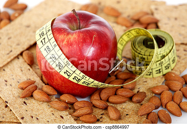Tailoring meter with biscuits and almonds - csp8864997