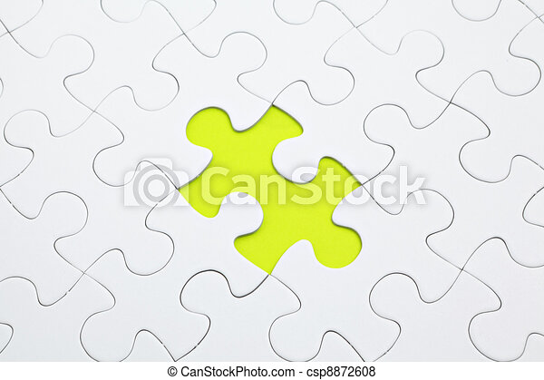 Jigsaw puzzle with green piece missed - csp8872608