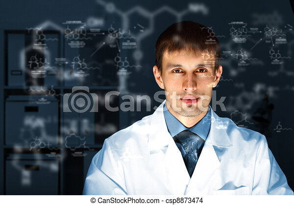 Young chemist working in laboratory - csp8873474