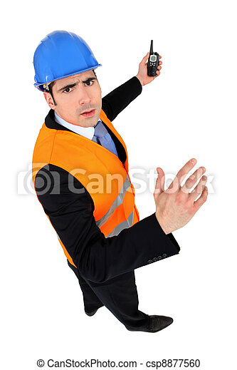 Man with helmet and radio transmitter - csp8877560