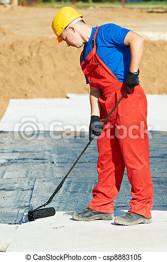 builder worker at roof insulation work - csp8883105