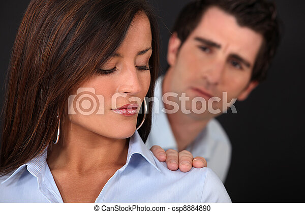 Concerned man touching his wife's shoulder - csp8884890