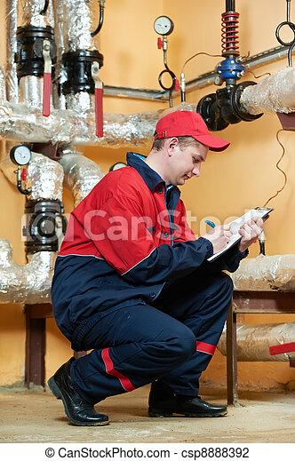 heating engineer repairman in boiler room - csp8888392