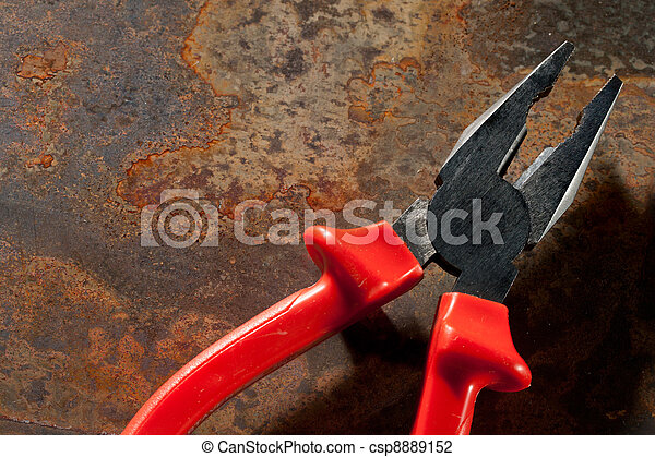Pliers on the rusty plate - csp8889152