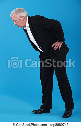 Stock Photos Of Man Bending Over To Look At Something On