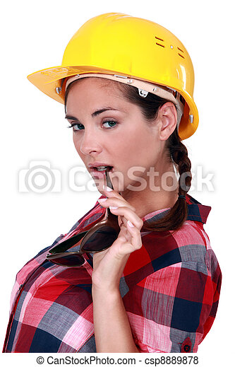 An alluring female construction worker with sunglasses. - csp8889878