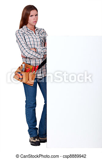 Angry woman standing behind a wall - csp8889942