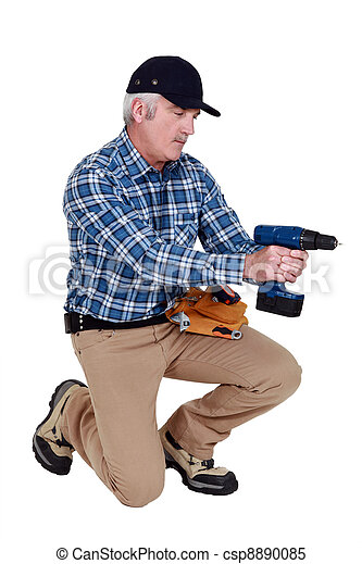 Grey haired man with drill - csp8890085
