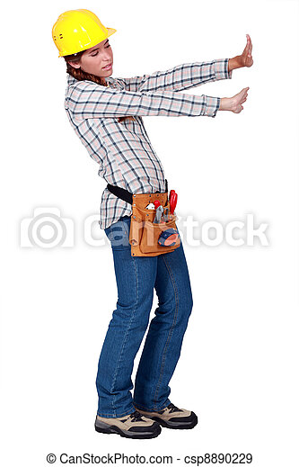 Tradeswoman pushing up against an invisible wall - csp8890229
