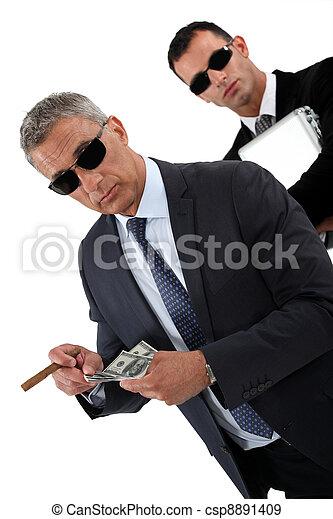 Wealthy businessmen - csp8891409