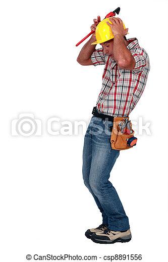 A construction worker afraid of a rodent. - csp8891556