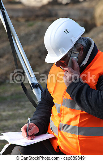 surveyor talking on the phone - csp8898491
