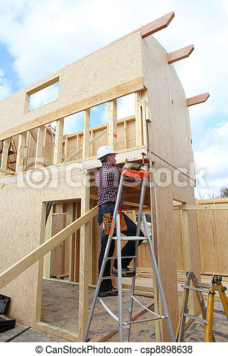 Construction worker building a house