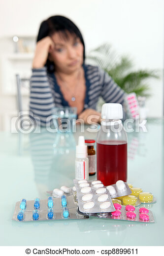 Woman sat in front of medication - csp8899611