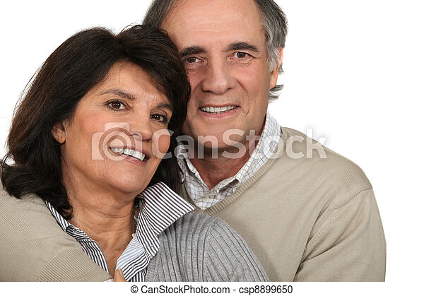 Middle-aged couple stood together - csp8899650
