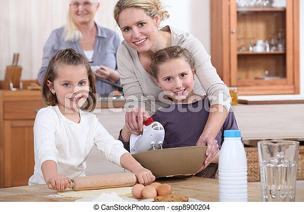 Three generations of women baking. - csp8900204