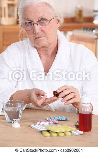 Unhappy elderly lady taking her medication - csp8902004
