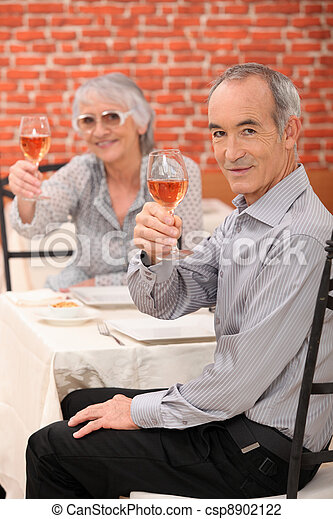 Elderly couple making a toast - csp8902122