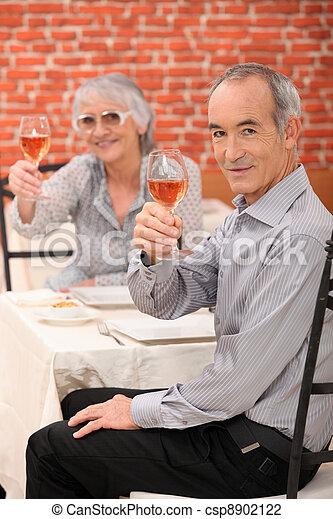 Elderly couple making a toast - csp8902122