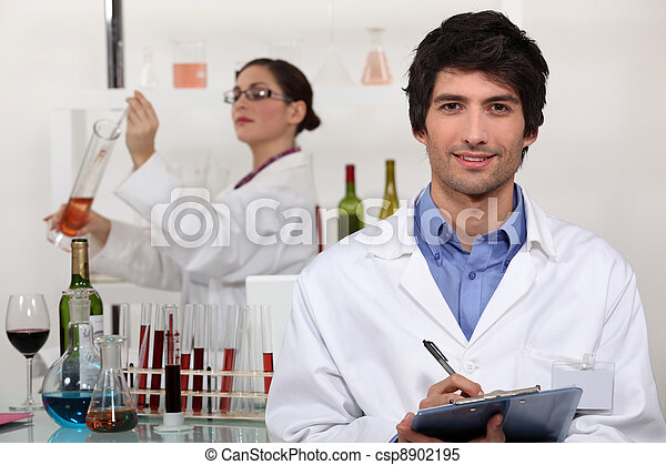 Two scientists in wine testing facility - csp8902195
