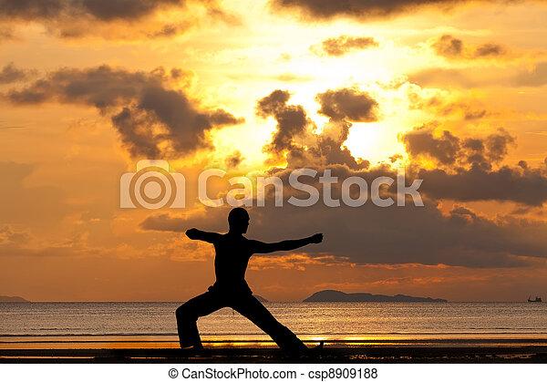 Man silhouette doing yoga exercise archer - csp8909188
