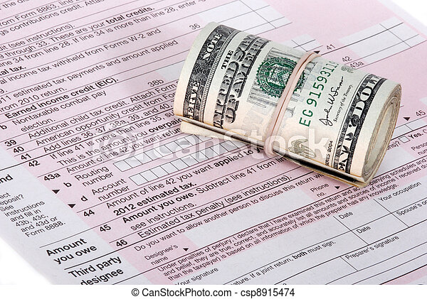 A roll of USD cash near an IRS tax form - csp8915474