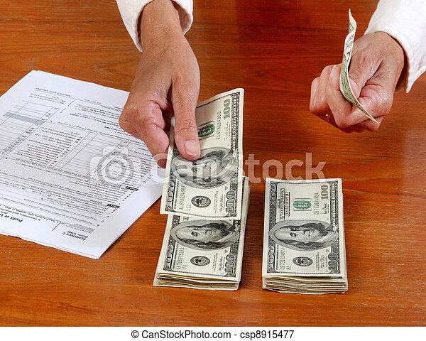 handling cash, tax forms - csp8915477