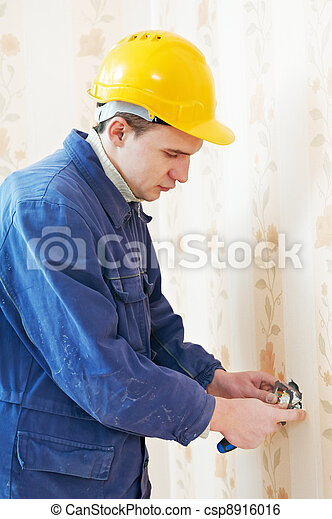 Electricians at cable wiring work - csp8916016