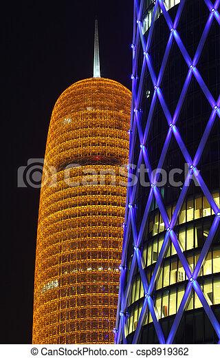 Burj Qatar and the blue illuminated QIPCO Tower in Doha, Qatar. Photo taken at 9th January 2012 - csp8919362