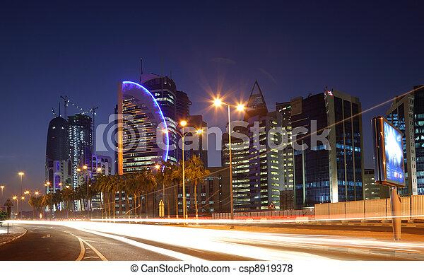 Street in Doha downtown at night, Qatar. Photo taken at 9th January 2012 - csp8919378