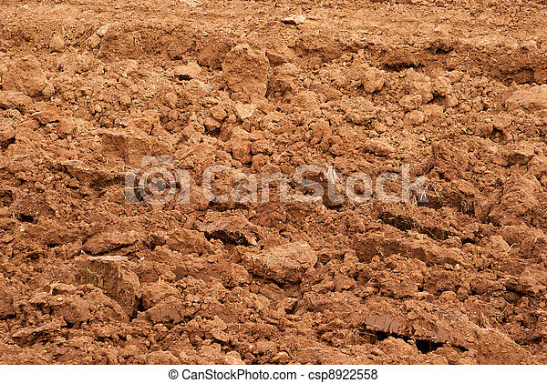 Clods of earth fresh plowing - csp8922558