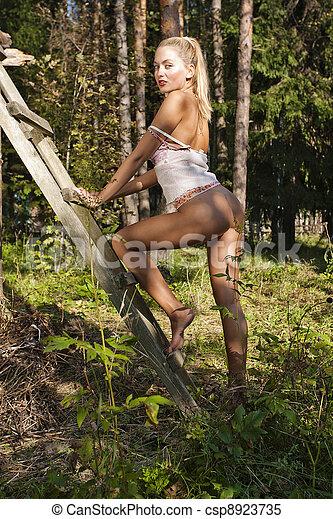 Pretty girl with bare butt - csp8923735