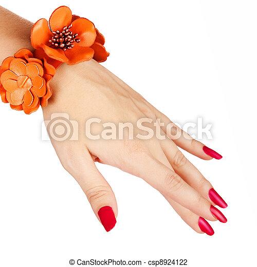 red manicure and orange bracelet - csp8924122