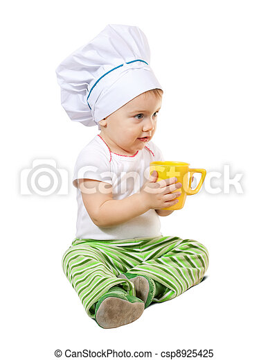 Baby cook in toque with cup - csp8925425