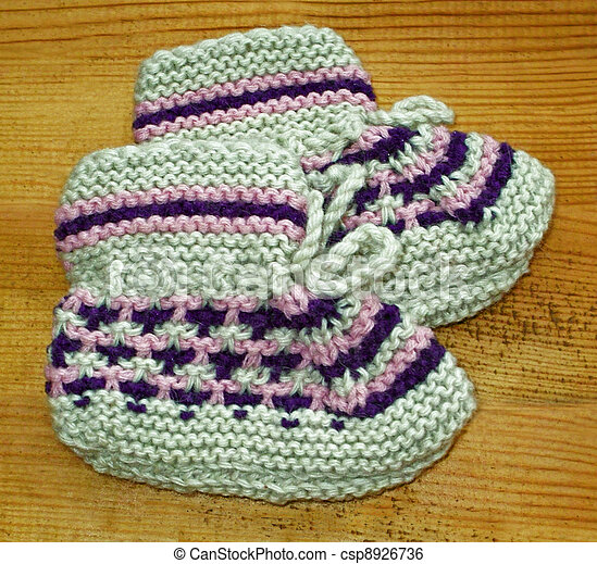 Hand knitted baby booties - csp8926736