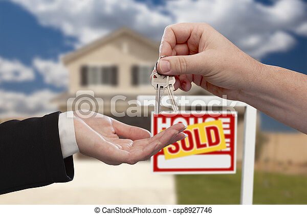 Handing Over the House Keys in Front of Sold New Home - csp8927746