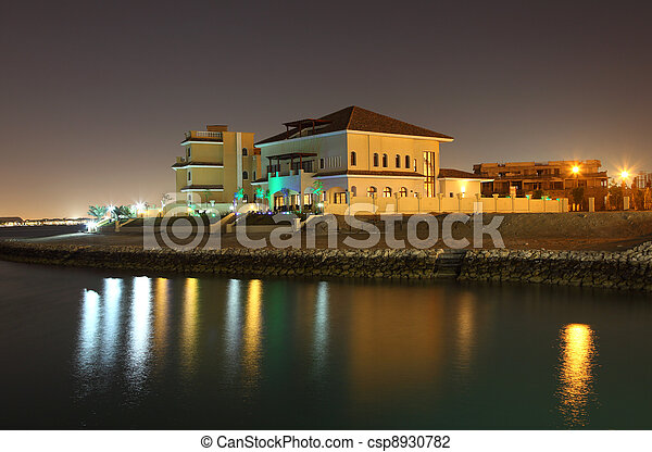 Residential buildings at night in The Pearl, Doha Qatar - csp8930782