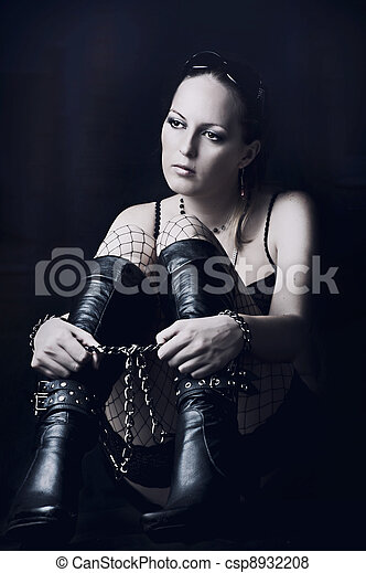 Sad woman in long black boots - csp8932208