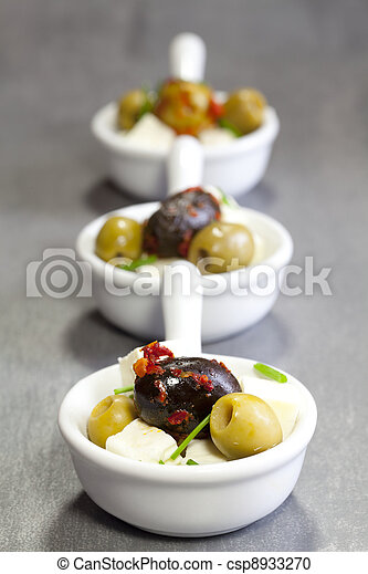 olives with feta cheese in a bowl - csp8933270