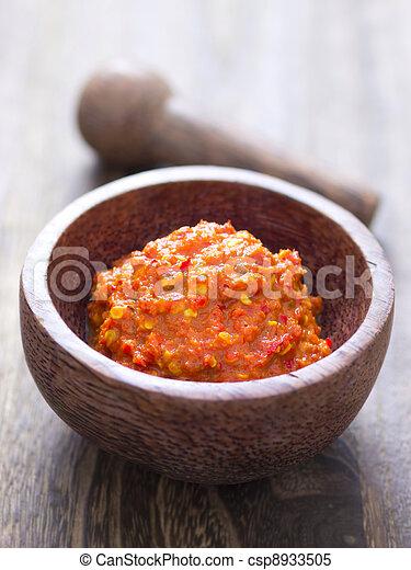 close up of a bowl of fermented shrimp paste - csp8933505