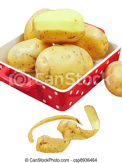 Raw potatoes in red tray and potato peels, isolated - csp8936464
