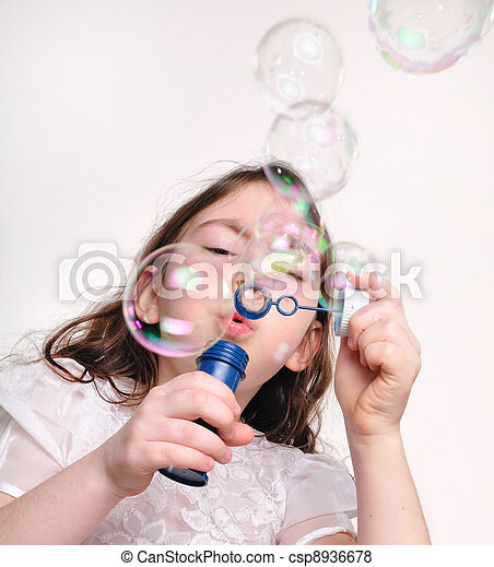 child blowing bubbles with bubble wand - csp8936678