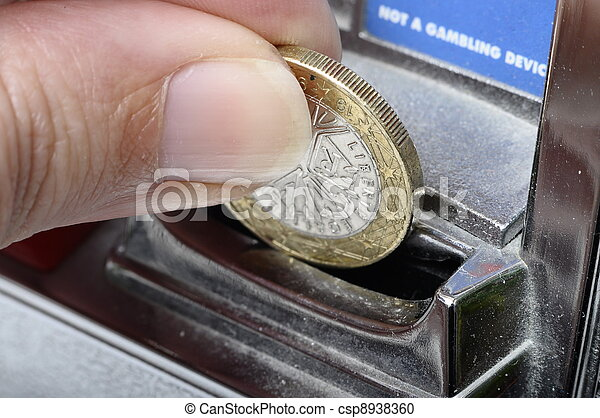 Slot machine : slot to introduce coins and finger holding euro coin - csp8938360