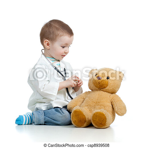 Adorable child with clothes of doctor and teddy bear over white - csp8939508
