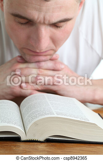 Man praying with the Bible - csp8942365