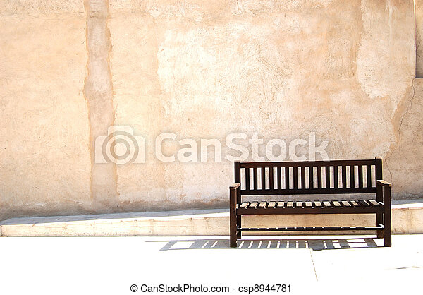 Bench on old town alley - csp8944781