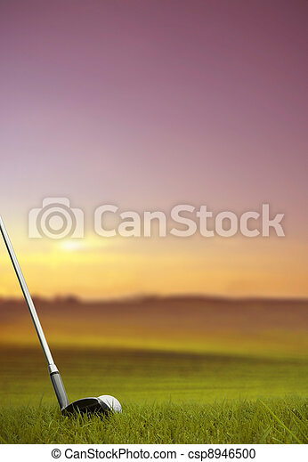 hitting golf ball along fairway at sunset - csp8946500